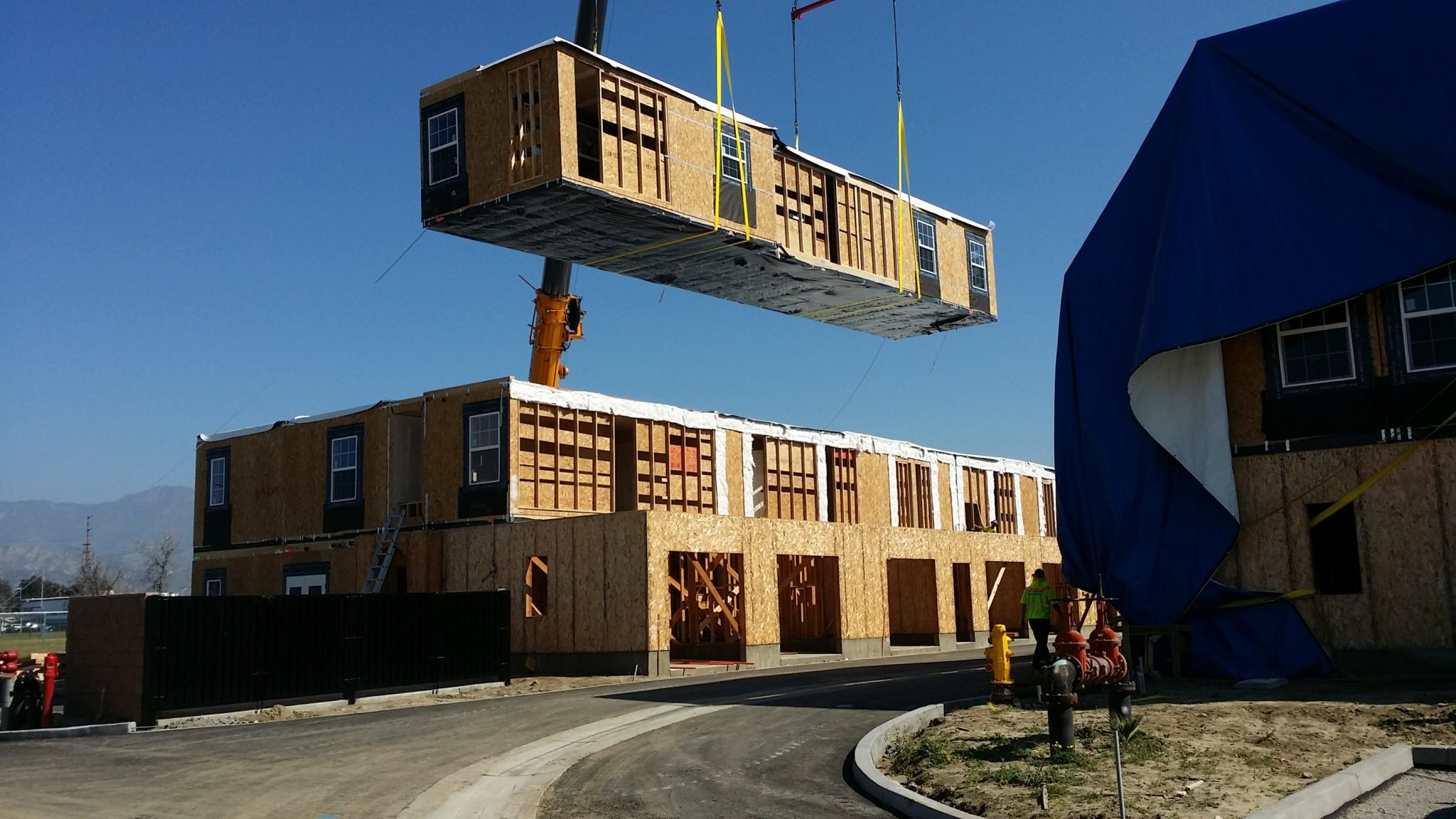 Southern california s largest modular affordable housing for Prefab multi family homes