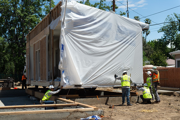 Crews Install Prefab Homes in Less Than a Day